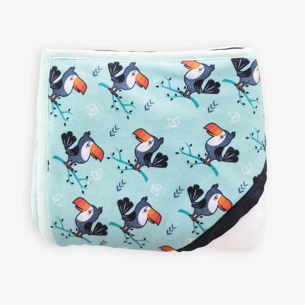 capa de baño de tucanes