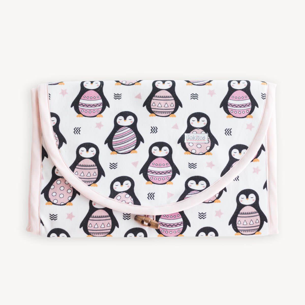 cambiador plegable de pingüinos rosas