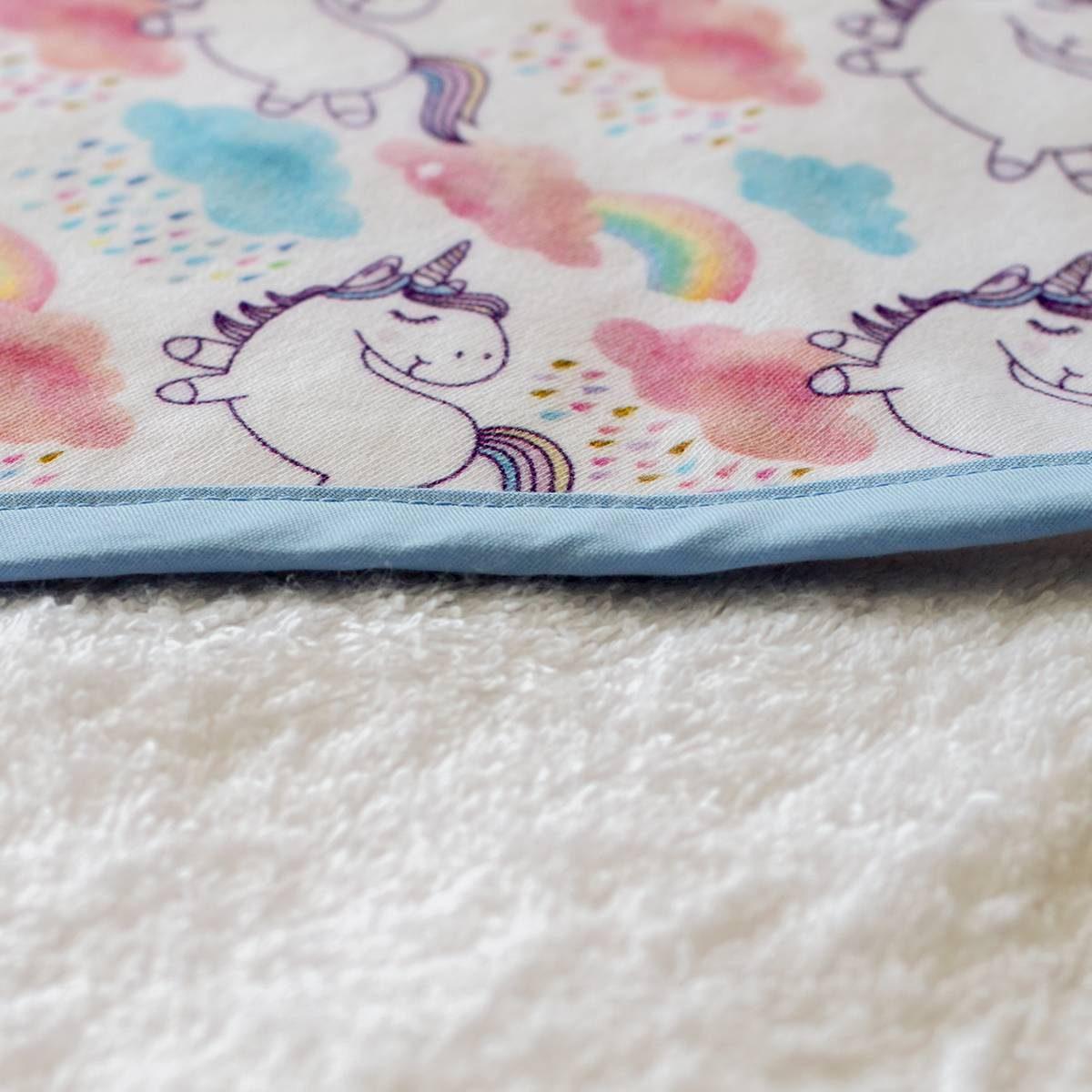Capa de baño de unicornios